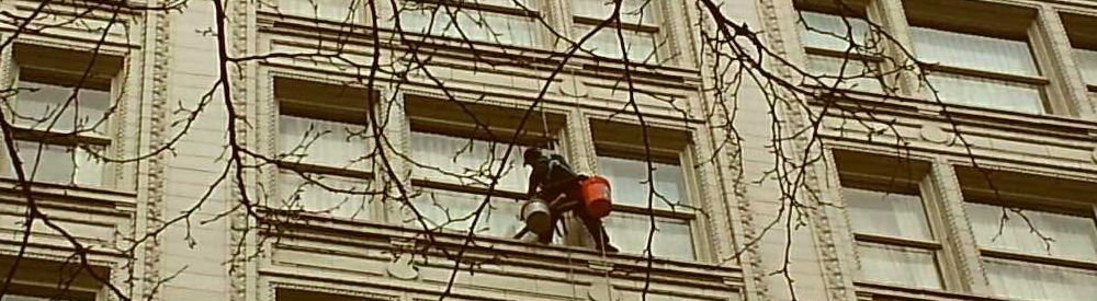 high rise window cleaning technician